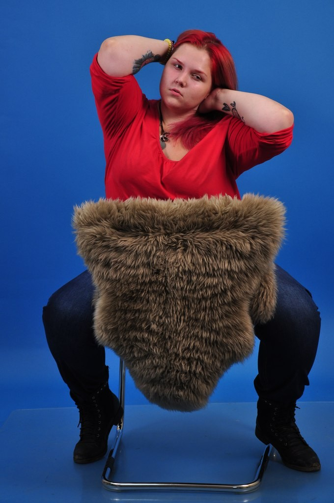 girl and furry chair