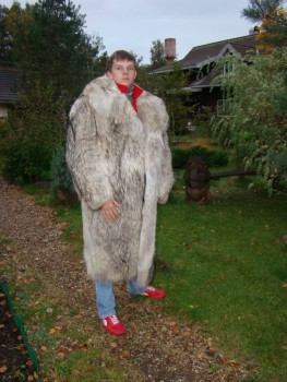 man in long furry coat